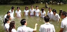 Chinese believers are baptized in water
